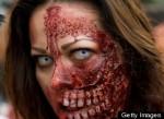A woman dressed up as a zombie takes par