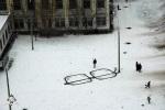 Snow and a light pole becomes art.