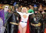 Cara Nicole, AZ Powergirl, with two batman and a joker