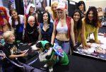 Cosplay Calendar Girls Admire Canine Cosplayer