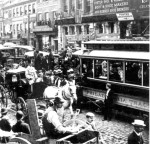 Horse-drawn wagons and carriages, an electric trolley car, and pedestrians congest a cobblestone Philadelphia street in 1897. (Courtesy of the National Archives)