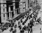 New York City's Fifth Avenue bustling with horse-drawn traffic and two motor cars. (Courtesy of the National Archives)