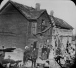 Residents in front of a dilapidated frame house in Kansas City, ca. 1900. (Courtesy of the National Archives)