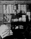 Treasury Department official, surrounded by packages of newly minted currency, counting and wrapping dollar bills. Washington, D.C., 1907. (Courtesy of the National Archives)