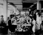 Women assembling dolls on a long worktable at the Shrenhat Toy Company, Philadelphia, Oct. 1912. (Courtesy of the National Archives)