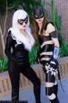 Black Cat and Caitlin Flucke as Carwoman